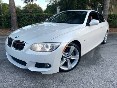 2011 BMW 3 Series for sale at CARPORT SALES AND  LEASING in Oviedo FL
