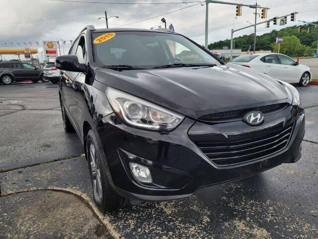 2015 Hyundai Tucson for sale at Dixie Automart LLC in Hamilton OH