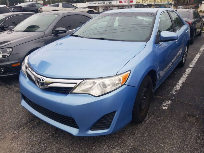 2014 Toyota Camry for sale at Castle Used Cars in Jacksonville FL