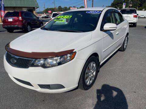2012 Kia Forte for sale at Cars for Less in Phenix City AL