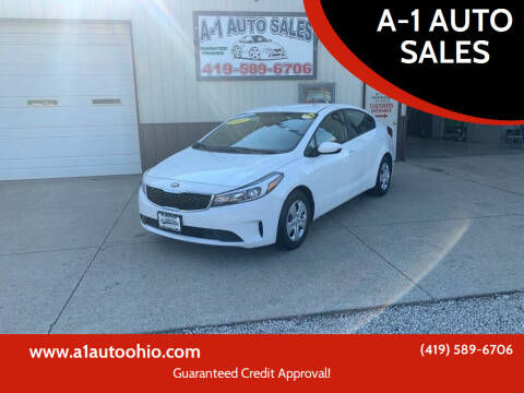 2017 Kia Forte for sale at A-1 AUTO SALES in Mansfield OH