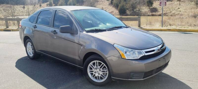 2011 Ford Focus for sale at BOOST MOTORS LLC in Sterling VA