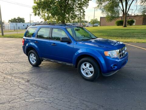 2011 Ford Escape for sale at Dittmar Auto Dealer LLC in Dayton OH