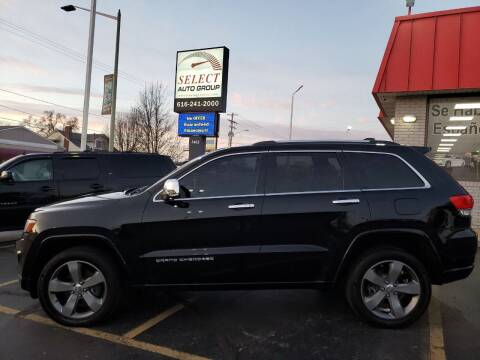 2014 Jeep Grand Cherokee for sale at Select Auto Group in Wyoming MI
