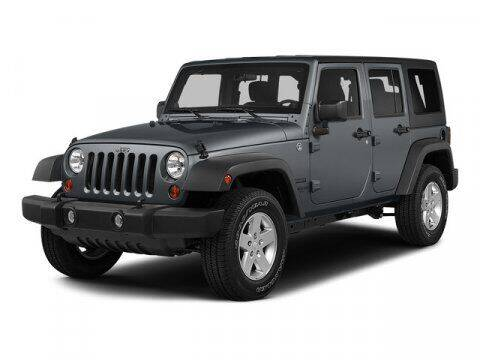 2015 Jeep Wrangler Unlimited for sale at HILAND TOYOTA in Moline IL