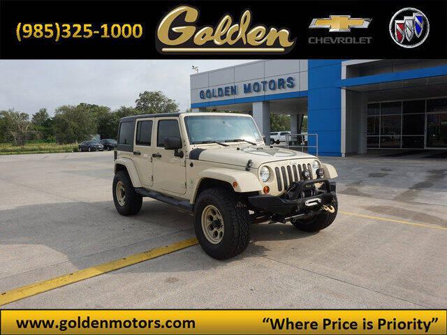 2011 Jeep Wrangler Unlimited for sale at GOLDEN MOTORS in Cut Off LA