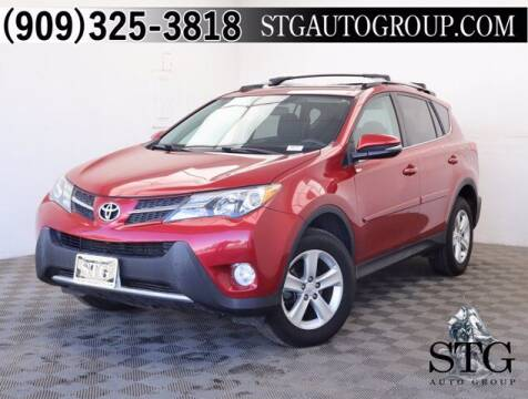 2013 Toyota RAV4 for sale at STG Auto Group in Montclair CA