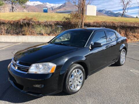 2013 Dodge Avenger for sale at DRIVE N BUY AUTO SALES in Ogden UT
