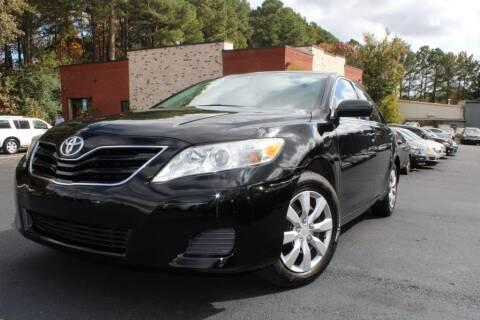 2011 Toyota Camry for sale at Atlanta Unique Auto Sales in Norcross GA