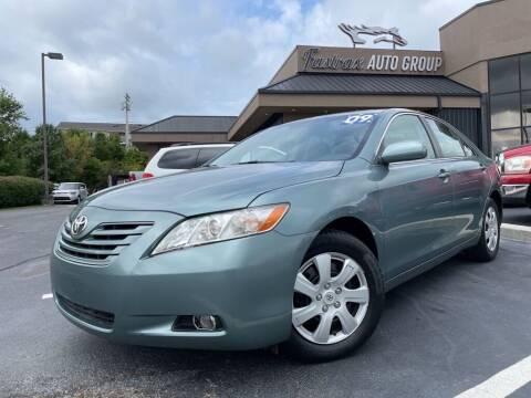 2009 Toyota Camry for sale at FASTRAX AUTO GROUP in Lawrenceburg KY
