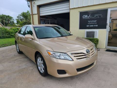 2011 Toyota Camry for sale at O & J Auto Sales in Royal Palm Beach FL