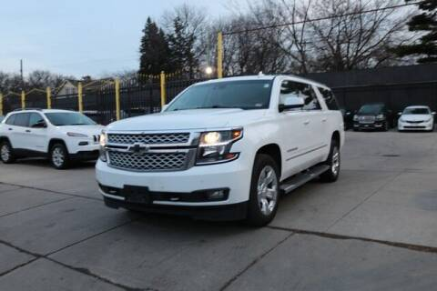 2017 Chevrolet Suburban for sale at F & M AUTO SALES in Detroit MI