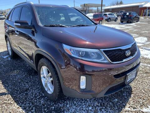2015 Kia Sorento for sale at BERKENKOTTER MOTORS in Brighton CO