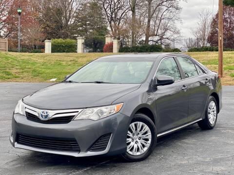 2013 Toyota Camry Hybrid for sale at Sebar Inc. in Greensboro NC