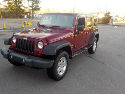 2012 Jeep Wrangler Unlimited for sale at RTE 123 Village Auto Sales Inc. in Attleboro MA