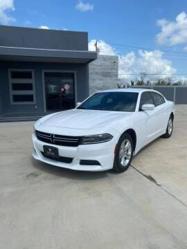 2015 Dodge Charger for sale at A & V MOTORS in Hidalgo TX