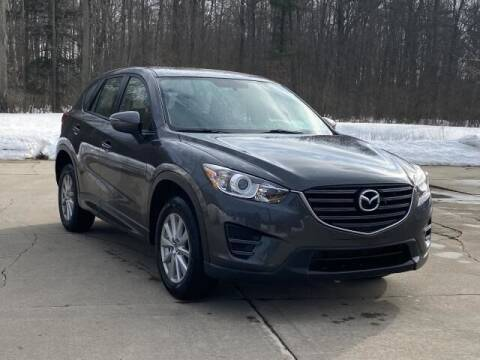 2016 Mazda CX-5 for sale at Betten Baker Preowned Center in Twin Lake MI