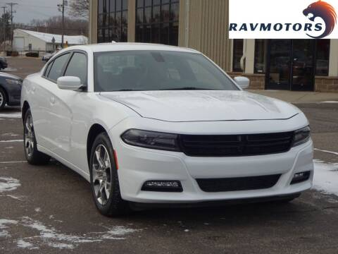 2016 Dodge Charger for sale at RAVMOTORS 2 in Crystal MN