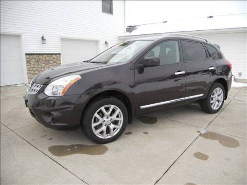 2011 Nissan Rogue for sale at OLSON AUTO EXCHANGE LLC in Stoughton WI