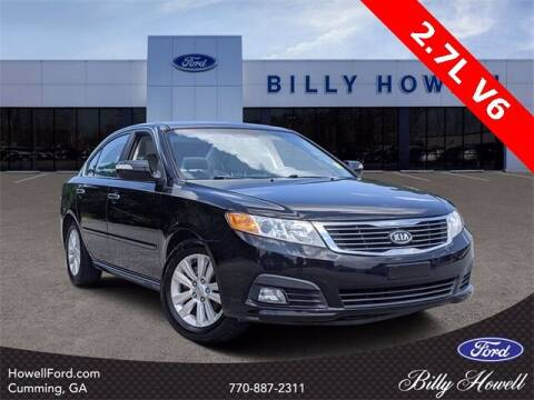 2010 Kia Optima for sale at BILLY HOWELL FORD LINCOLN in Cumming GA