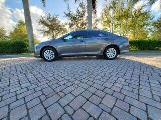 2014 Toyota Camry for sale at Used Cars Cape Coral -- World Champions Auto Inc in Cape Coral FL