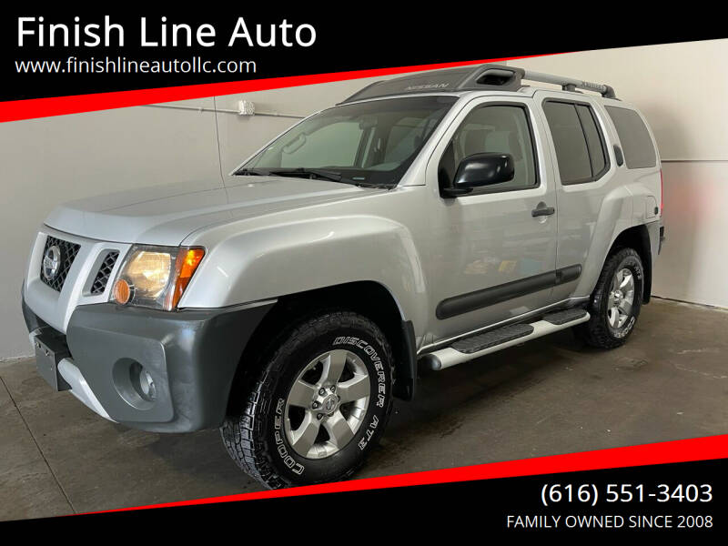 2013 Nissan Xterra for sale at Finish Line Auto in Comstock Park MI