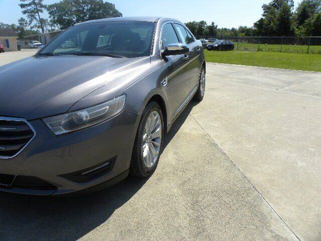 2014 Ford Taurus for sale at VANN'S AUTO MART in Jesup GA