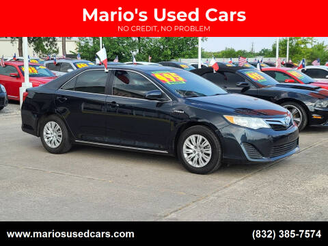2012 Toyota Camry Hybrid for sale at Mario's Used Cars in Houston TX