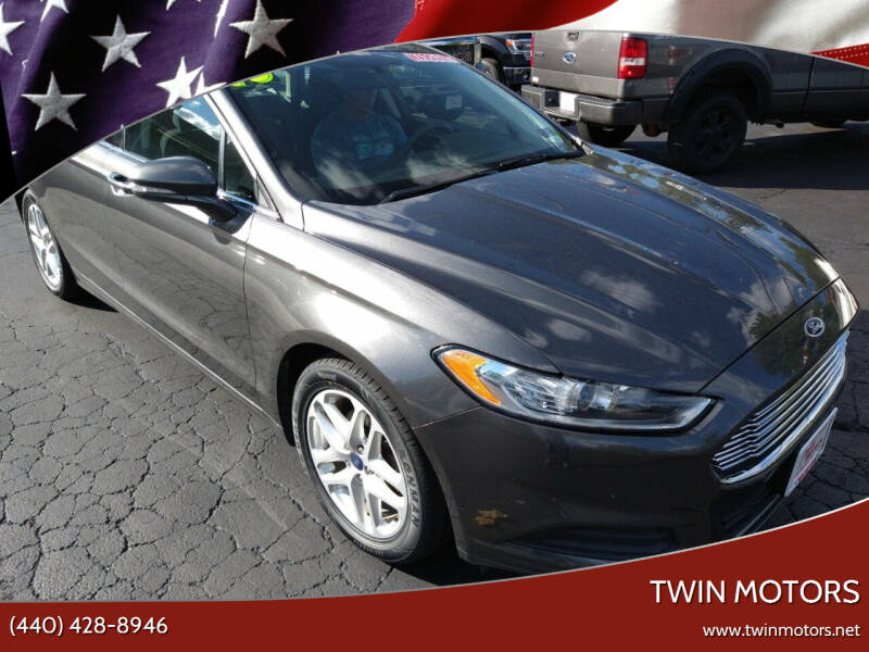 2015 Ford Fusion for sale at TWIN MOTORS in Madison OH