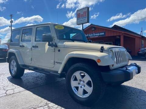 2011 Jeep Wrangler Unlimited for sale at HUFF AUTO GROUP in Jackson MI