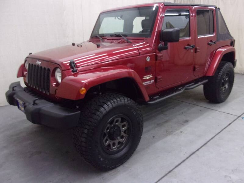 2013 Jeep Wrangler Unlimited for sale at Paquet Auto Sales in Madison OH