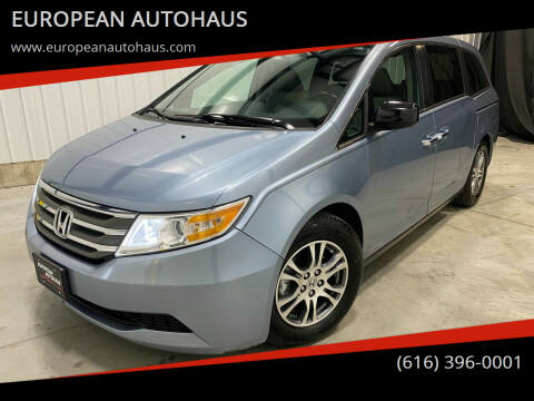 2013 Honda Odyssey for sale at EUROPEAN AUTOHAUS in Holland MI