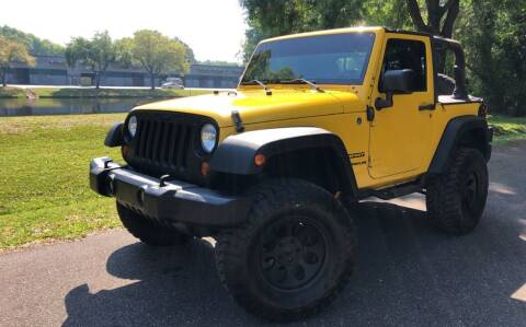 2011 Jeep Wrangler for sale at Powerhouse Automotive in Tampa FL