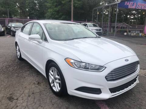 2013 Ford Fusion for sale at Fast and Friendly Auto Sales LLC in Decatur GA