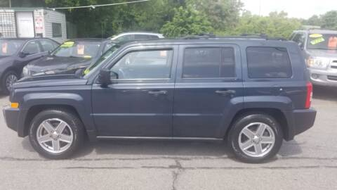 2008 Jeep Patriot for sale at Howe's Auto Sales in Lowell MA