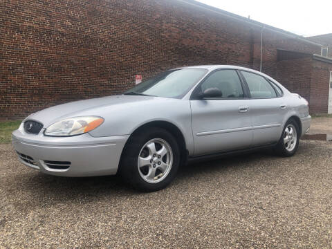 2007 Ford Taurus for sale at Jim's Hometown Auto Sales LLC in Byesville OH