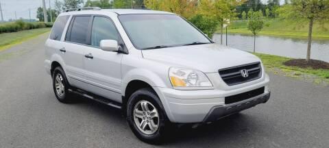 2003 Honda Pilot for sale at BOOST MOTORS LLC in Sterling VA