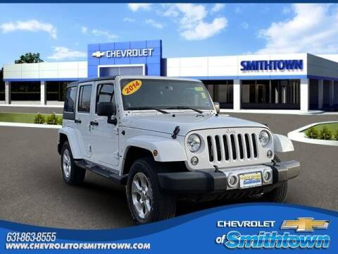 2014 Jeep Wrangler Unlimited for sale at CHEVROLET OF SMITHTOWN in Saint James NY