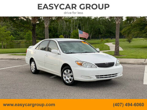 2003 Toyota Camry for sale at EASYCAR GROUP in Orlando FL