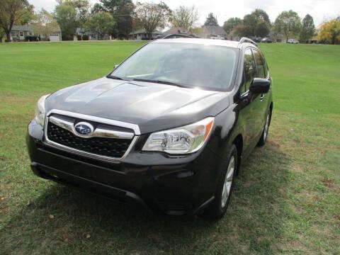 2014 Subaru Forester for sale at Triangle Auto Sales in Elgin IL