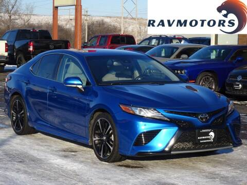 2018 Toyota Camry for sale at RAVMOTORS in Burnsville MN