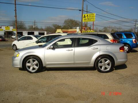 2011 Dodge Avenger for sale at A-1 Auto Sales in Conroe TX
