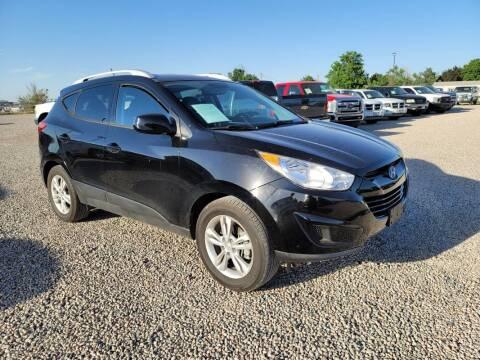 2011 Hyundai Tucson for sale at BERKENKOTTER MOTORS in Brighton CO