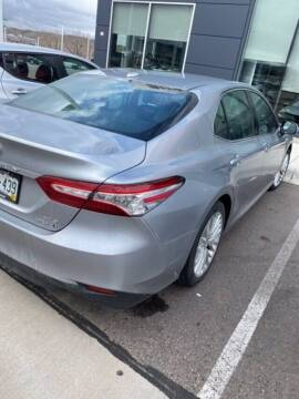 2019 Toyota Camry Hybrid for sale at EMPIRE LAKEWOOD NISSAN in Lakewood CO
