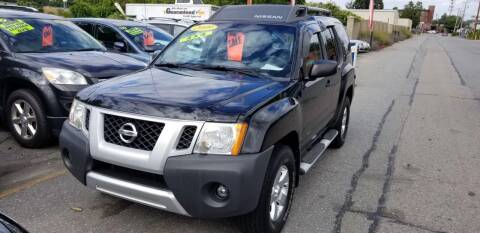 2009 Nissan Xterra for sale at Howe's Auto Sales in Lowell MA
