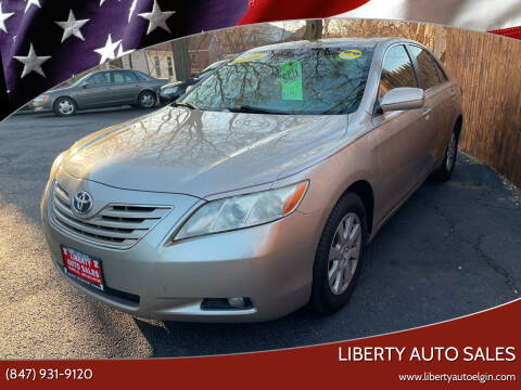 2009 Toyota Camry for sale at Liberty Auto Sales in Elgin IL
