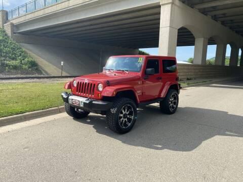 2011 Jeep Wrangler for sale at Apple Auto in La Crescent MN