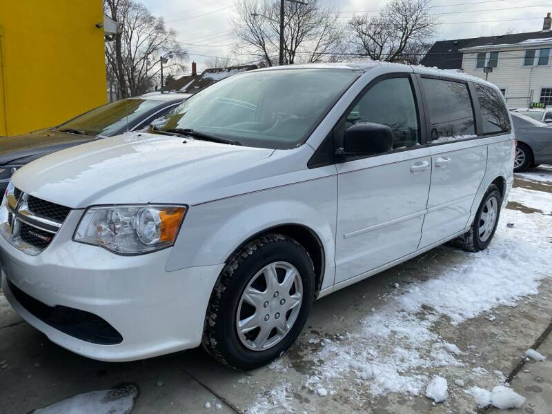 2014 Dodge Grand Caravan for sale at C & M Auto Sales in Detroit MI