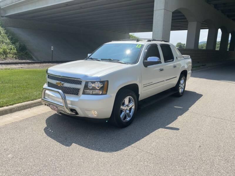 2013 Chevrolet Avalanche for sale at Apple Auto in La Crescent MN
