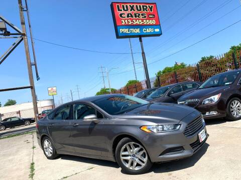 2013 Ford Fusion for sale at Dymix Used Autos & Luxury Cars Inc in Detroit MI